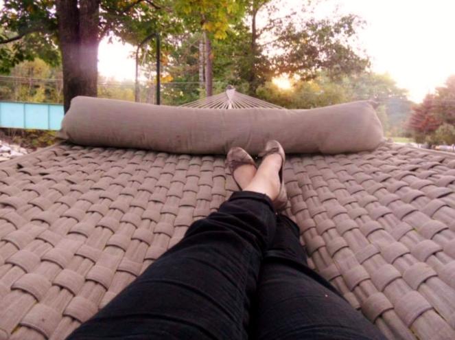 Relaxing in a riverside hammock