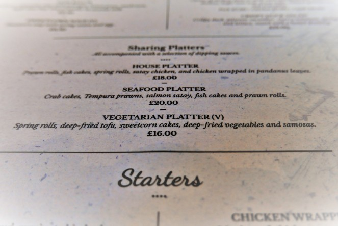Perusing the menu at Siamais Birmingham