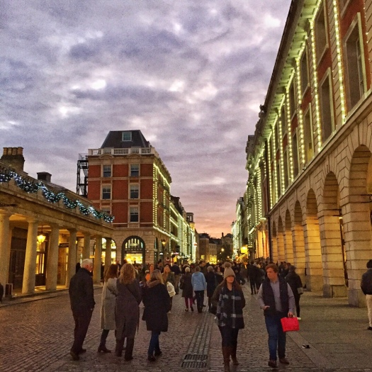 Dramatic pink and grey clouds over an early evening Covent Garden