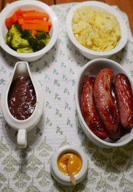 Sausages, mash, onion gravy, carrots, broccoli and mustard