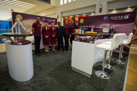 The team at Qatar Airways ready to welcome frequent fliers to the Business Class Lounge