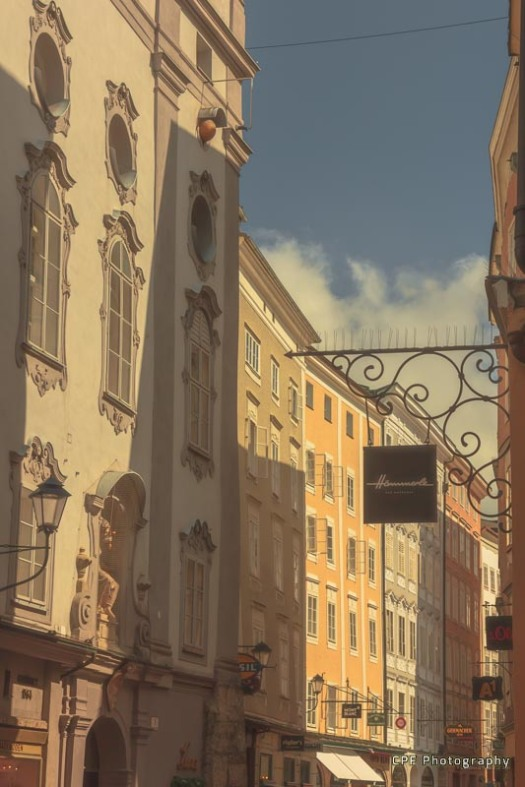 The pastel coloured tall buildings of Geitridegasse in Salzburg