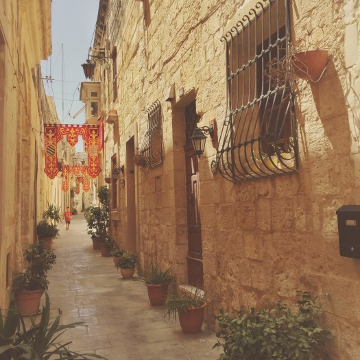 Rabat, Malta, narrow streets, festival, sandstone buildings, plant pots