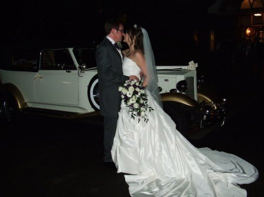 Wedding couple at night, Beauford wedding car, wedding dress, purple and cream bouquet, Ardencote Manor