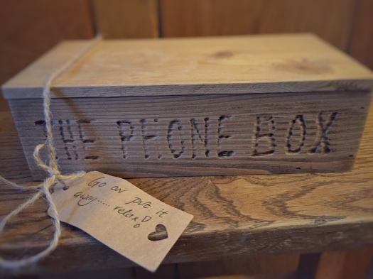 Wooden phone box to lock away your mobile phone during your stay